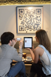 Customers scan the artwork to read a taster from a famous book